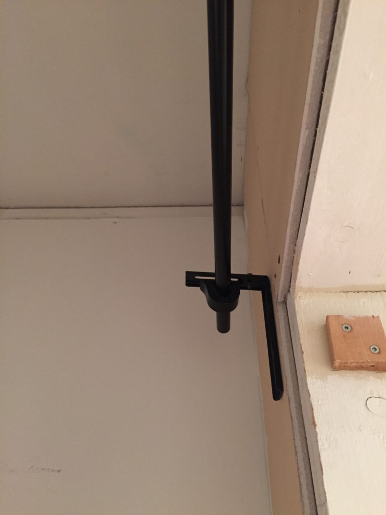 rods inside mount for curtain in closet