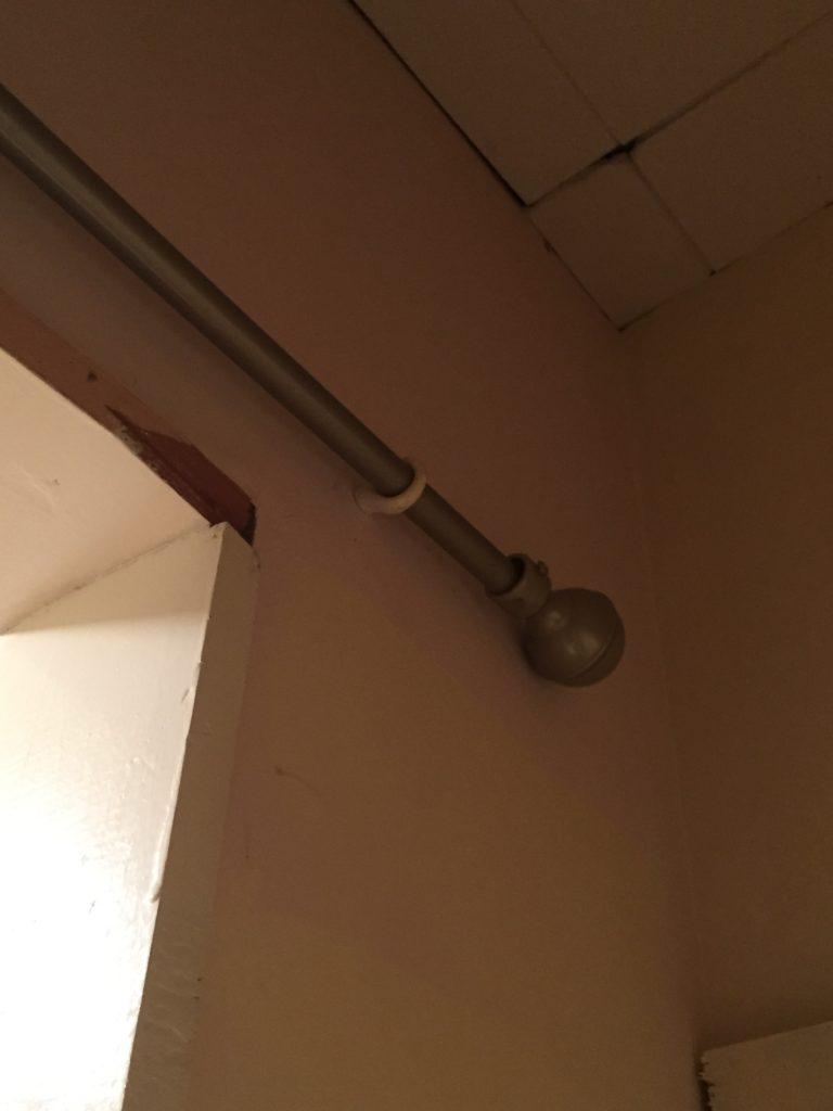 Mounting rod inside closet