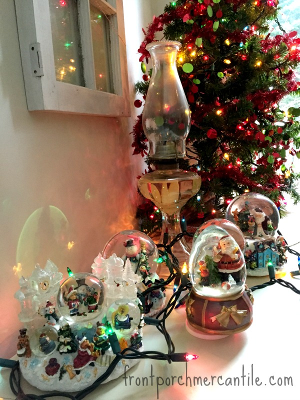 Snow globes and coloured lights Front Porch Mercantile