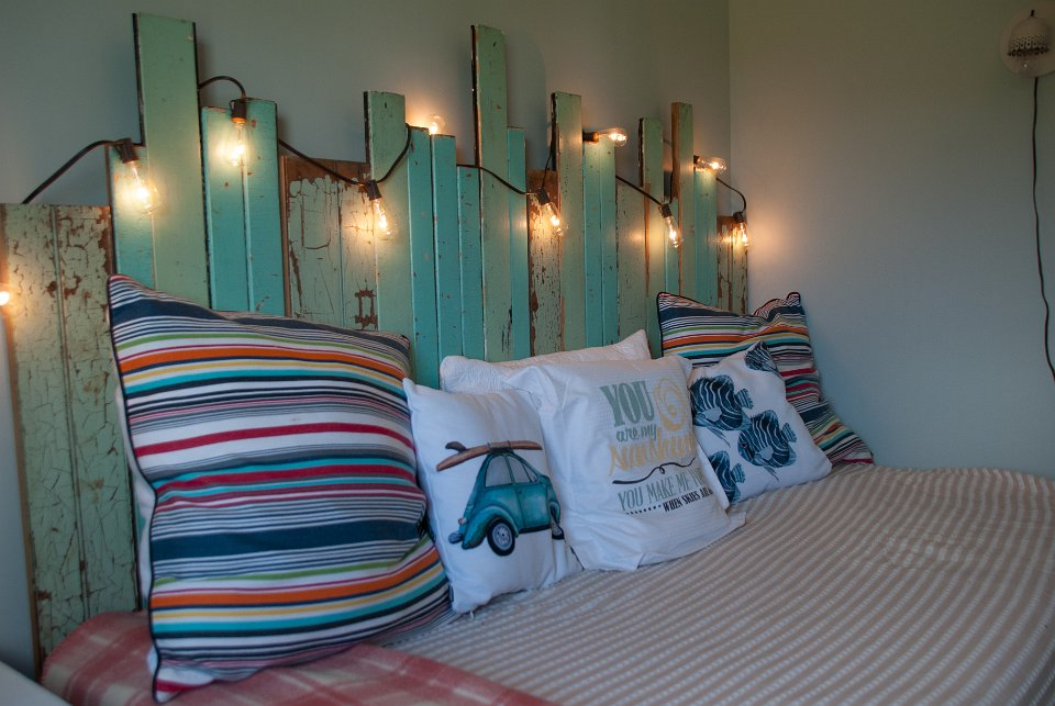 Picket fence headboard and beautiful fun pillows