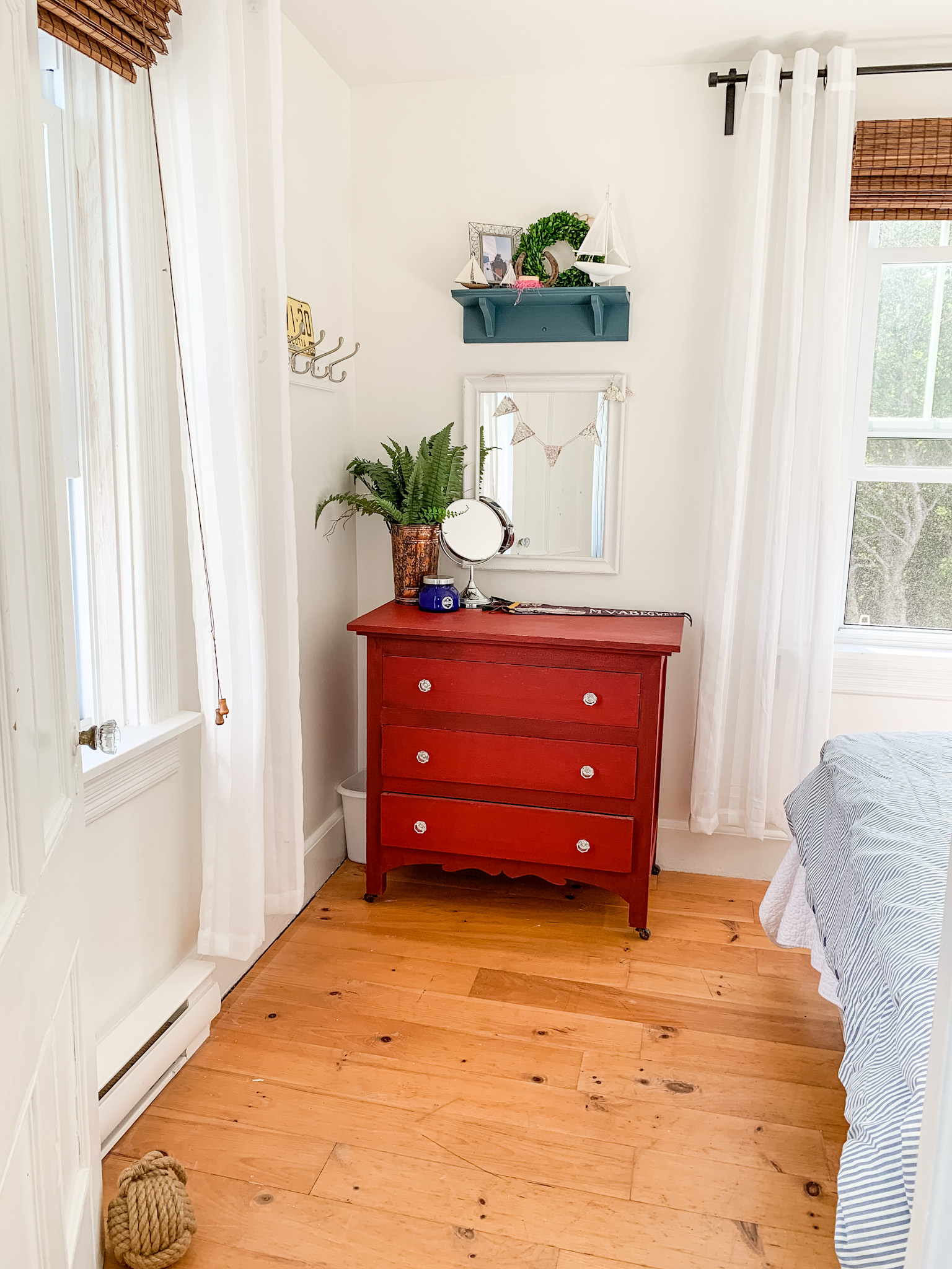 Front Porch Mercantile guest room makeover - red dresser in milk paint
